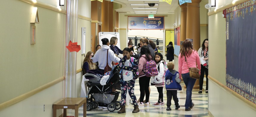 Students, parents, and teachers fill a hallway at Blix Elementary School, Monday, Sept. 17, 2018, in Tacoma, Wash.
