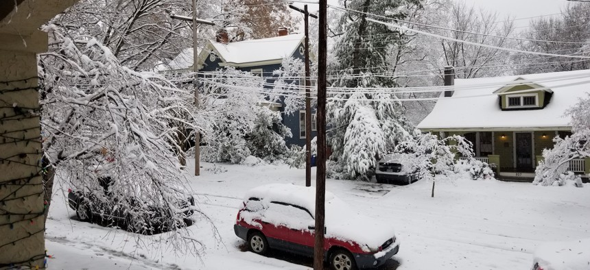 Most of this snow in Raleigh's Boylan Heights neighborhood melted within a few hours on Sunday, but schools were closed on Monday and again on Tuesday.