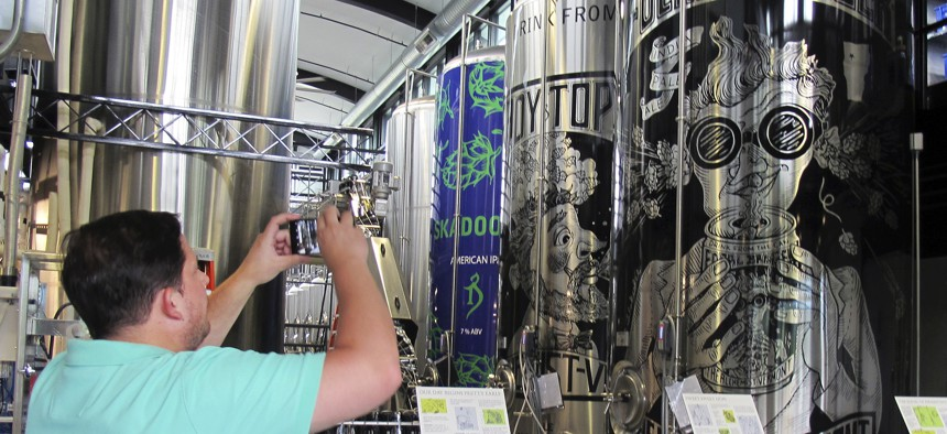 A tourist from New York City visits the Alchemist brewery in Stowe, Vermont. Vermont is trying to tempt tourists into becoming residents, part of an economic development strategy focused on luring new workers, rather than businesses.
