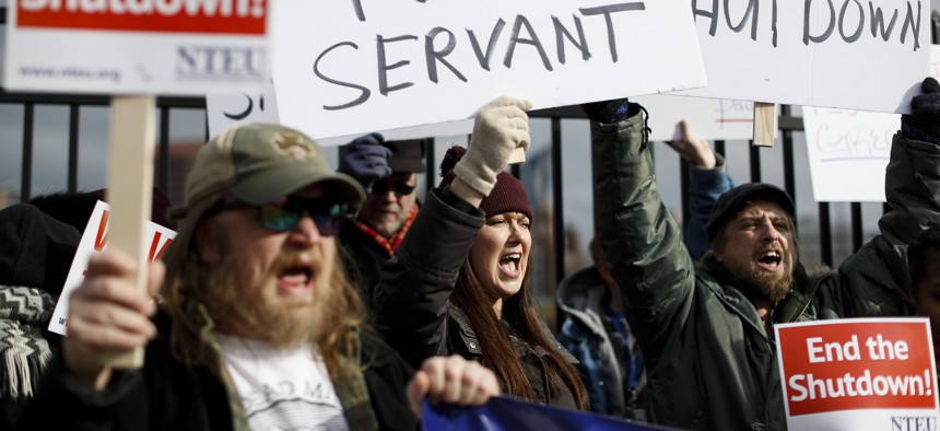 Union members and Internal Revenue Service workers rally outside an IRS Service Center to call for an end to the partial government shutdown, Thursday, Jan. 10, 2019, in Covington, Ky.