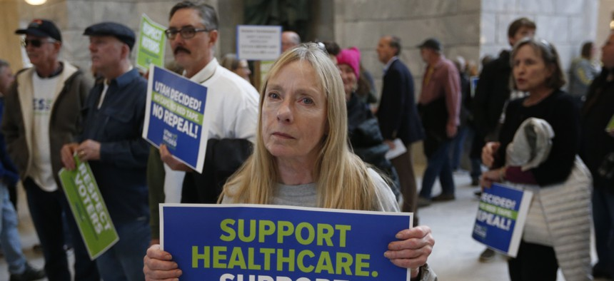 Supporters of a voter-approved measure to fully expand Medicaid gather others at a rally to ask lawmakers not to change the law during the first day of the Utah Legislature, at the Utah State Capitol, Monday, Jan. 28, 2019, in Salt Lake City.