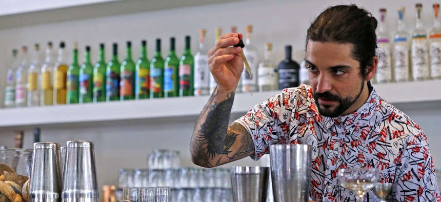A bartender at the restaurant Gracias Madre in West Hollywood mixes a CBD cocktail.