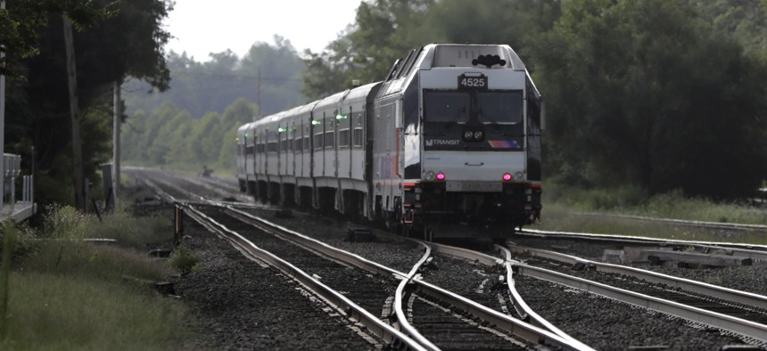 This Aug. 3, 2018 file photo shows a New Jersey Transit train leaving the Bound Brook Station in Bound Brook, N.J.