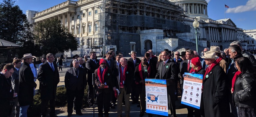 County officials gathered outside the U.S. Capitol on Tuesday to push for public lands payment programs.