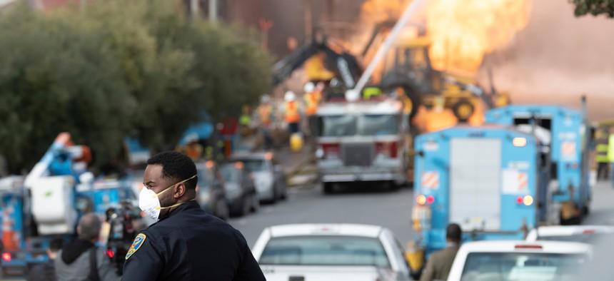 Firefighters battle a gas main blaze on Geary Blvd. in San Francisco's Richmond District in February.