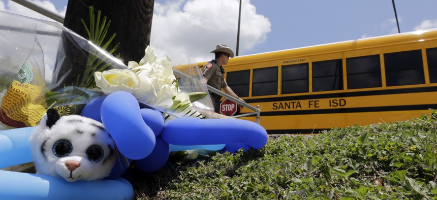 A bus carrying students arrives at Santa Fe High School in Santa Fe, Texas, on May 19, 2018. Students and teachers were allowed inside parts of the school to retrieve their belongings. A gunman opened fire inside the school May 18, 2018.