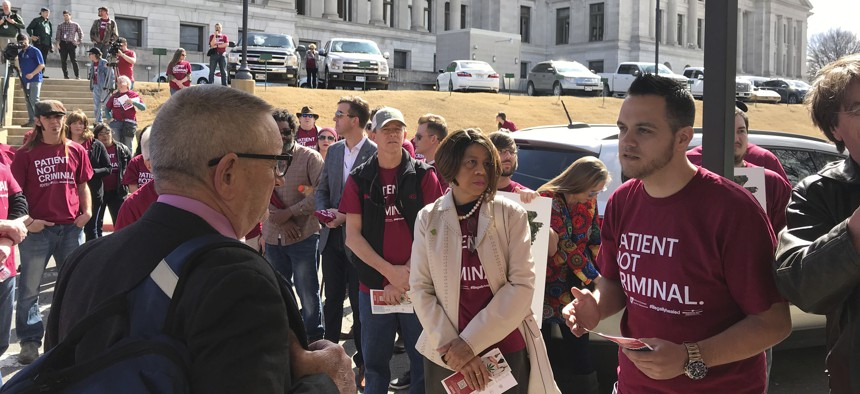 Corey Hunt with the Arkansas Cannabis Industry Association talked with state Rep. Douglas House outside the Arkansas State Capitol on Feb. 27, 2018 about changes the group wanted to the state's medical marijuana program.