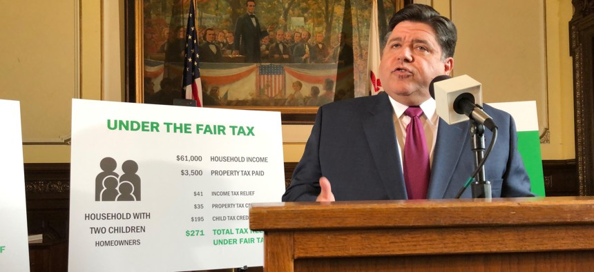 Gov. J.B. Pritzker outlines his plan to replace Illinois' flat-rate income tax with a graduated structure, during a state Capitol news conference on Thursday, March 7, 2019 in Springfield.