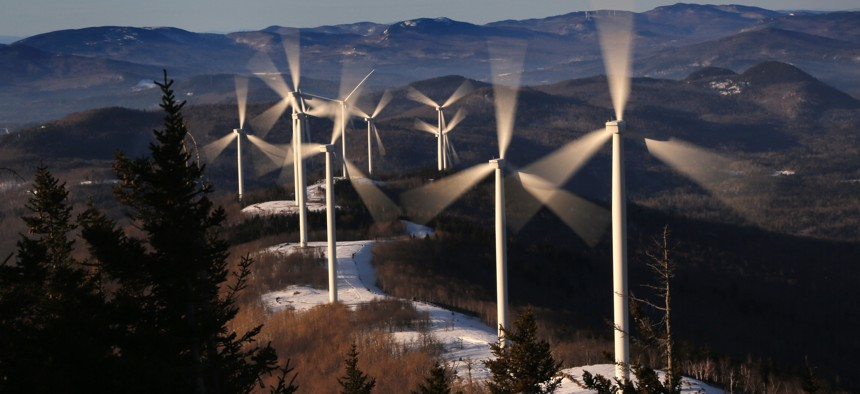 The blades of wind turbines catch the breeze at the Saddleback Ridge wind farm in Carthage, Maine.