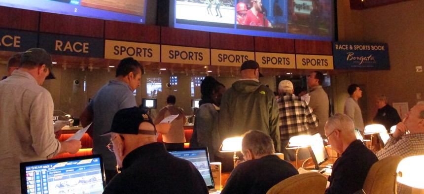 Gamblers line up to place bets on the NCAA men's college basketball tournament at the Borgata casino in Atlantic City N.J., on March 21, 2019.