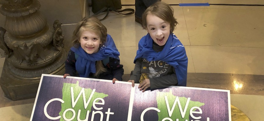 Noelle Fries, 6, left, and Galen Biel, 6, both of Minneapolis, attend a rally at the Minnesota Capitol on April 1, 2019, to kick off a year-long drive to try to ensure that all Minnesota residents are counted in the 2020 census.