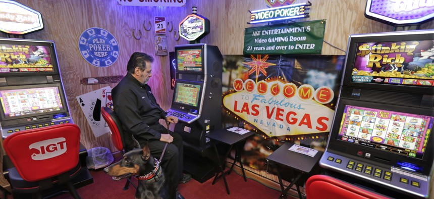 Michael Vena, owner of Arabian Knights Farms and Training Center, shows off the farm's gaming room in Willowbrook, Illinois.