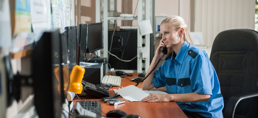 A 911 operator answers at a call center.