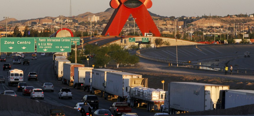 A row of trucks wait to cross the border with the United States in Ciudad Juarez, Mexico, Tuesday, April 9, 2019.