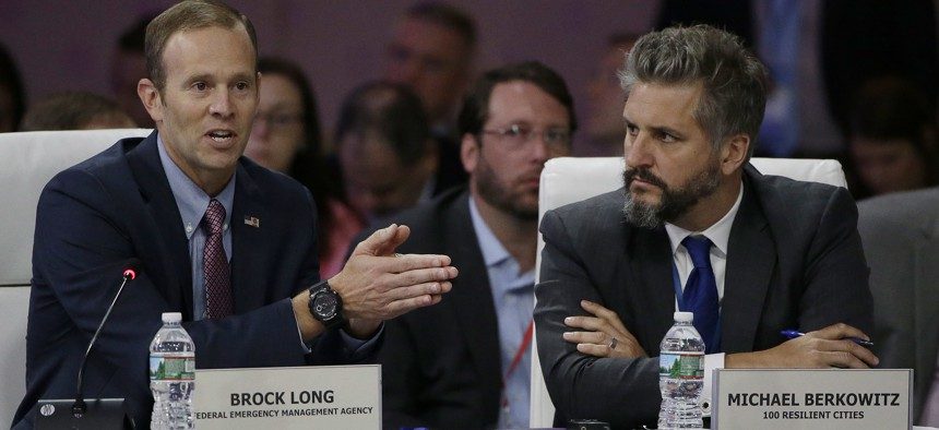 """Former FEMA Administrator Brock Long, left, addresses a session entitled """"Preparing for the Extreme: Building Resilient Communities"""" as 100 Resilient Cities President Michael Berkowitz, right, looks on during a 2017 National Governors Association meeting."""