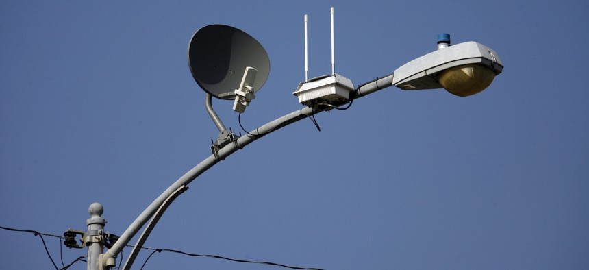 A transmitter with two antennas for wireless, high-speed Internet is seen strapped to a light pole on a residential street, Wednesday, May 16, 2007 in Lompoc, California.