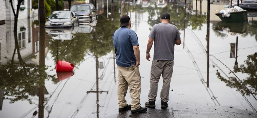 People inspect the floodwaters submerging Broadway in Westville, N.J. Thursday, June 20, 2019. Severe storms containing heavy rains and strong winds spurred flooding across southern New Jersey.