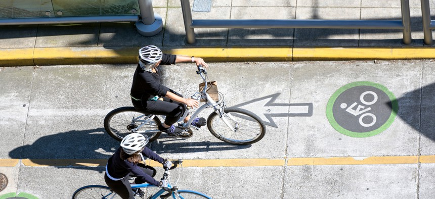 Protected lanes for cyclists, like this one in Portland, make getting to work on a bike a low-stress option.
