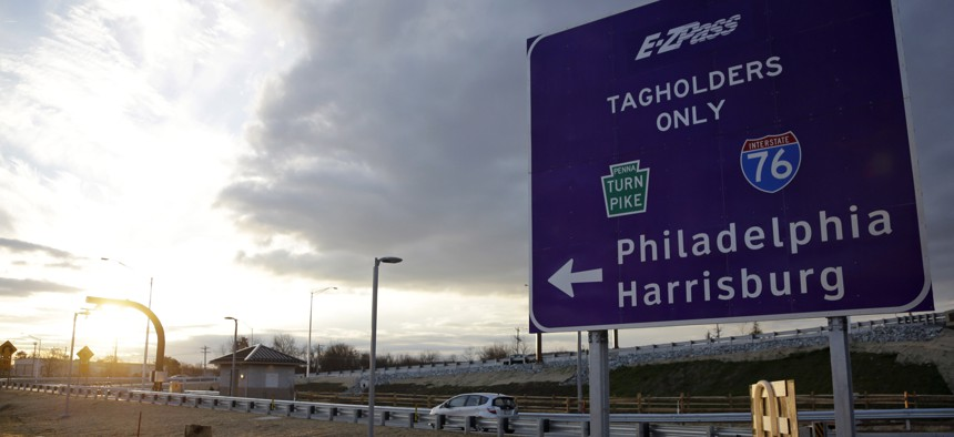 In this file photo taken Dec. 11, 2012, a driver enters the Pennsylvania Turnpike at a newly completed E-ZPass Only electronic interchange in Malvern, Pa.