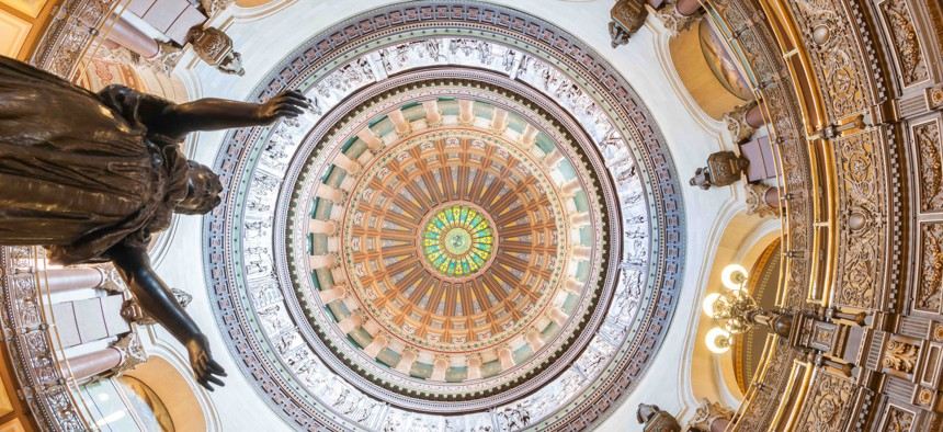 The dome inside the Illinois State Capitol. A proposed lawsuit over debt in the state came as lawmakers in the state continue to grapple with deficits and other budget issues.