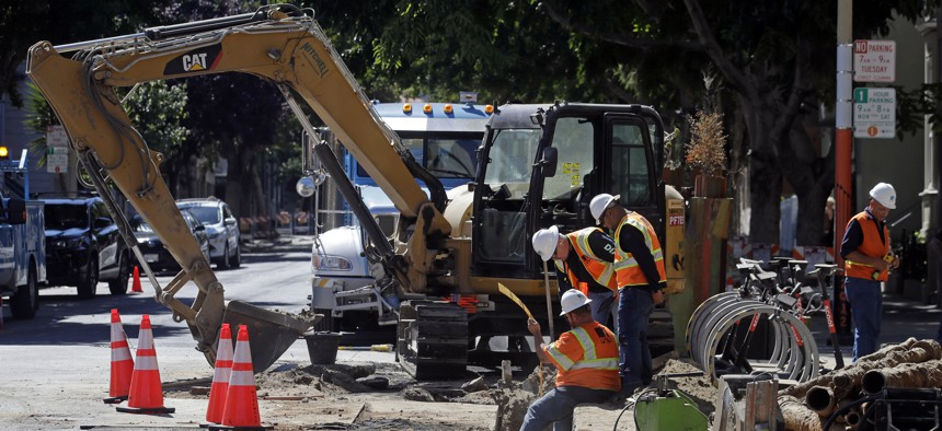 A Pacific Gas & Electric crew working in San Francisco. San Francisco officials are offering to buy Pacific Gas & Electric's power lines and other infrastructure in the city for $2.5 billion.