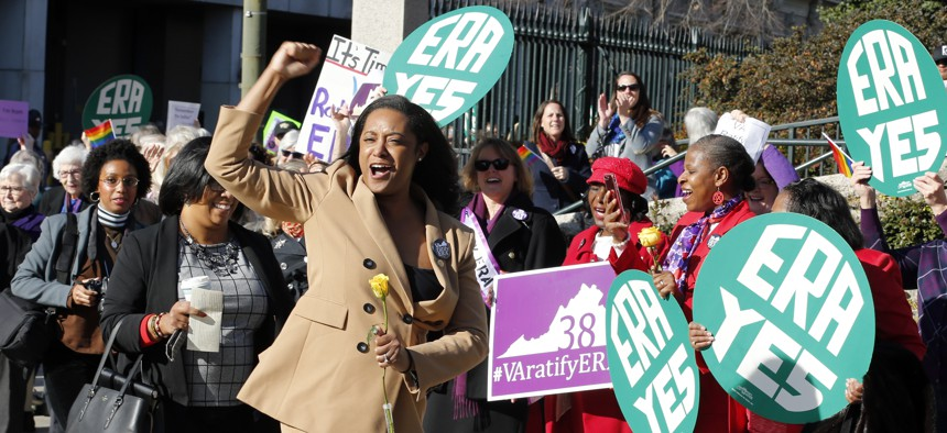 Virginia Delegate Jennifer Carroll Foy cheers on Equal Rights Amendment demonstrators outside the Capitol in Richmond in January.