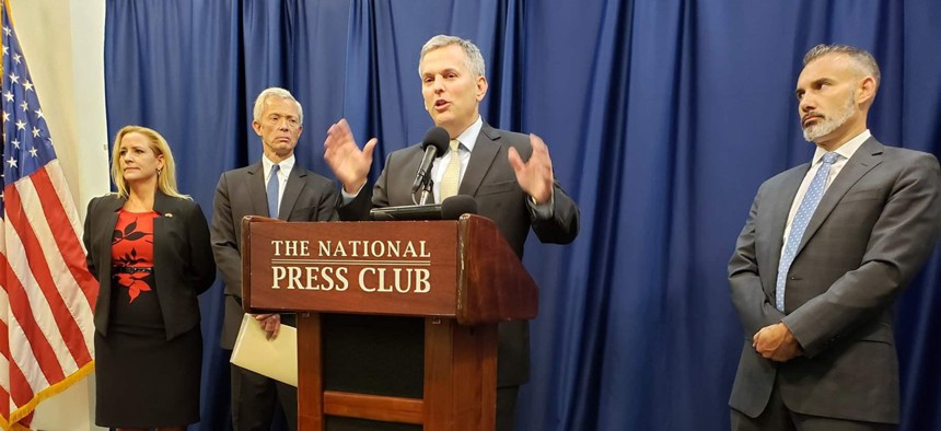 North Carolina Attorney General Josh Stein appears at a press conference in Washington, D.C., in August to announce an agreement among a group of attorneys general with major telecom companies in an effort to block robocall scams.