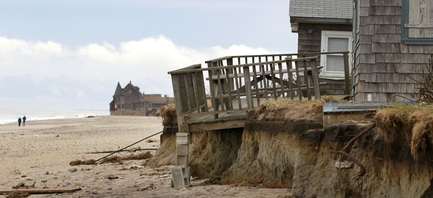 In this Tuesday, Nov. 13, 2012 photo, cottages rest near an eroded shoreline on Roy Carpenter's Beach, in South Kingstown, R.I.