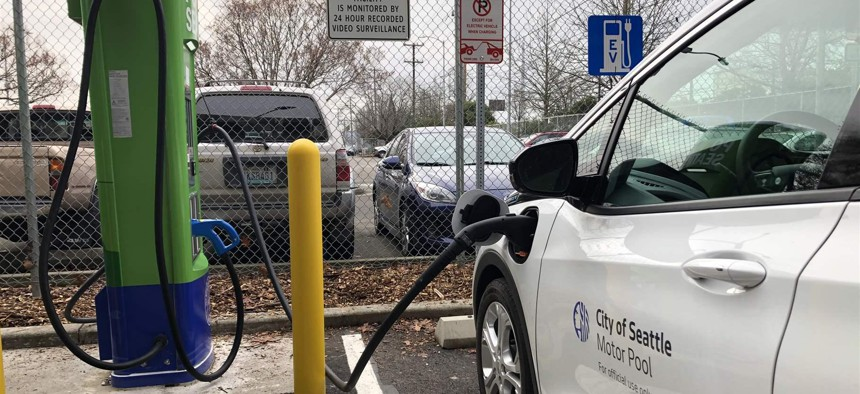 A Seattle City Light vehicle charges at one of the utility's new electric vehicle charging stations in the city's SoDo neighborhood.