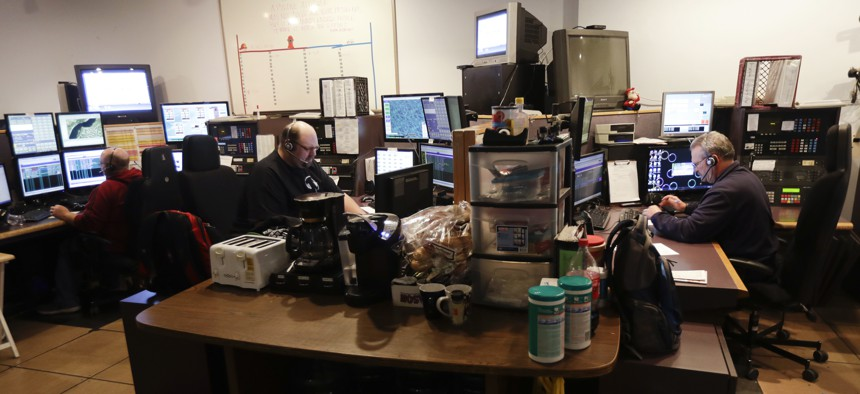 Communications officers in 2016 work in the 911 dispatch center at the Rensselaer County Public Safety Building in Troy, N.Y.