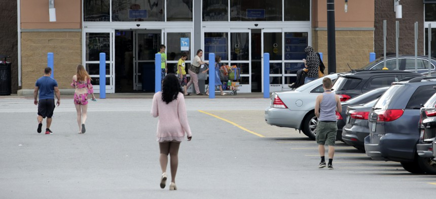Shoppers head into a retail store.