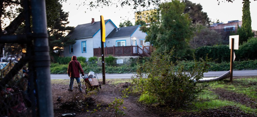 """Every other week, Norm Ciha and his homeless neighbors temporarily relocate their camp from land alongside a freeway off-ramp in Oakland, Calif., to a nearby vacant lot, until state cleanup crews have come and gone. They call it """"the Caltrans Shuffle."""""""