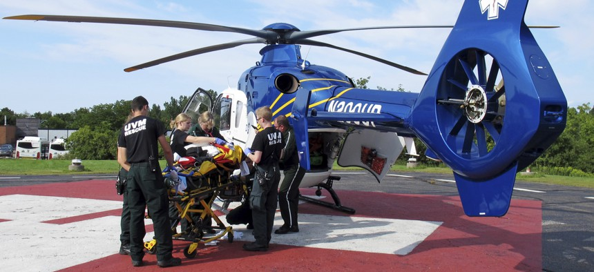 Emergency workers off load a patient from a helicopter at the University of Vermont Medical Center in Burlington, Vt., Thursday 23, 2018.