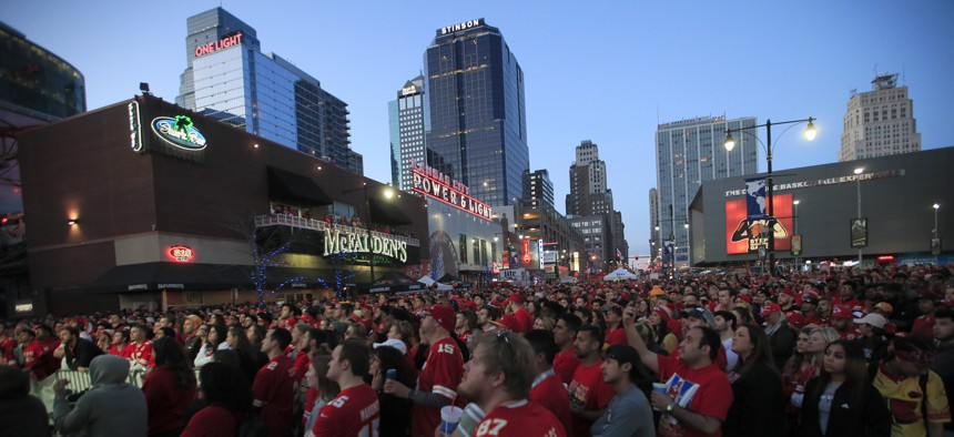 Kansas City Chiefs fans watch the Super Bowl at the Power and Light District in Kansas City, Mo., Sunday, Feb. 2, 2020.
