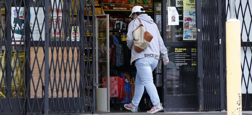 A customer enters a store in a north Tulsa, Okla. neighborhood in 2016.
