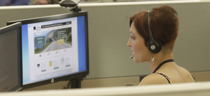 In this 2013 file photo, an employee of Covered California, the state's health insurance exchange, provides information at a call center in Rancho Cordova, Calif.