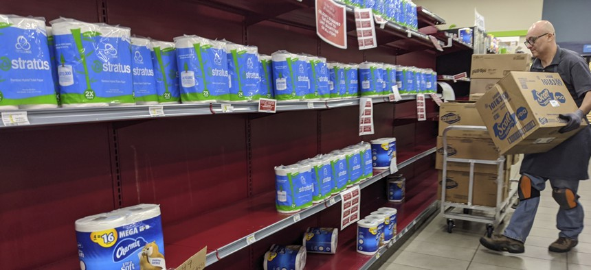 Toilet paper is restocked at the Gelson's Market in Los Feliz neighborhood of Los Angeles on Thursday, March 26, 2020.