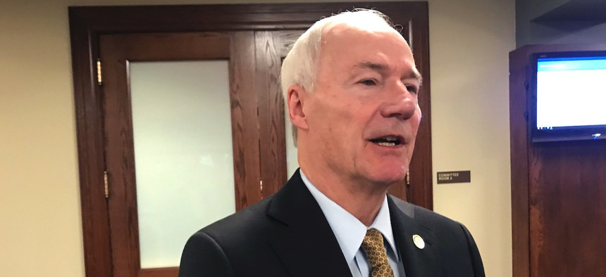 """Arkansas Gov. Asa Hutchinson said the payments would """"alleviate some of the financial stress"""" for the roughly 26,000 caregivers who are eligible to receive them."""