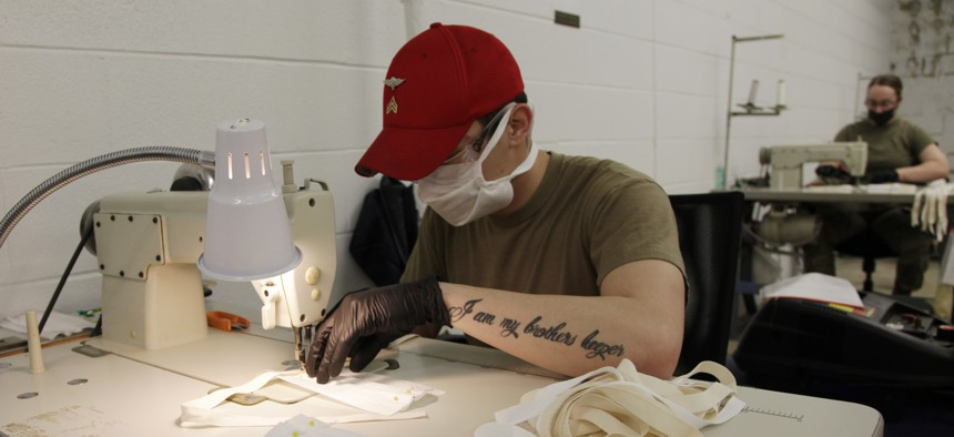 A U.S. Army paratrooper assigned to the 347th Quartermaster Company sews together a cloth face mask at Fort Bragg, N.C. Parachute riggers are constructing PPE, while continuing to support Fort Bragg's ongoing Airborne operations.
