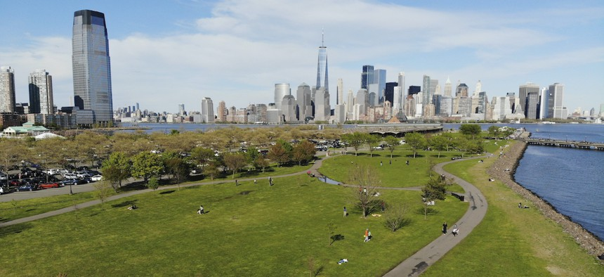 """People enjoy the good weather while keeping their distance from one another at Liberty State Park in Jersey City, N.J., Saturday, May 2, 2020. Gov. Phil Murphy said early reports of behavior at the state's newly reopened parks were """"so far, so good."""""""