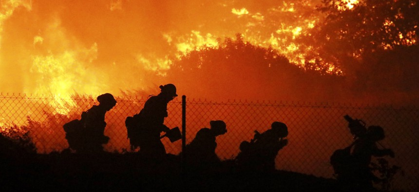 Firefighters battle the Saddleridge fire in Sylmar, Calif., Friday Oct. 11, 2019.