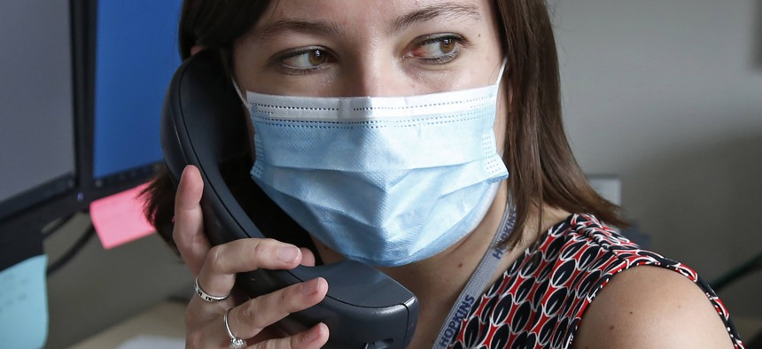 A health investigator in Salt Lake County, Utah works the phones in this May 19 photograph. States and local governments around the U.S. are looking to expand coronavirus contact tracing programs.
