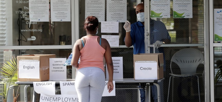 A woman files for unemployment in Miami.