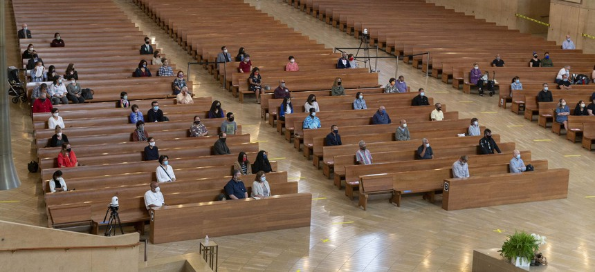 A hundred faithful sit while minding social distancing during Mass at Cathedral of Our Lady of the Angels in Los Angeles on June 7. It was the first Mass since church services there were suspended in March due to the coronavirus outbreak.