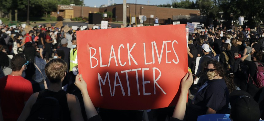 Several hundred protesters block a street outside the police station Wednesday, June 10, 2020, in Florissant, Mo.