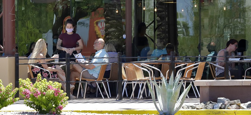 Guests dine in-house at a restaurant on May 13, 2020, in Phoenix.
