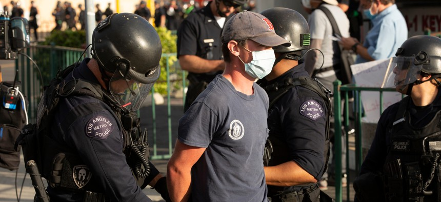 A protester is arrested in Los Angeles.