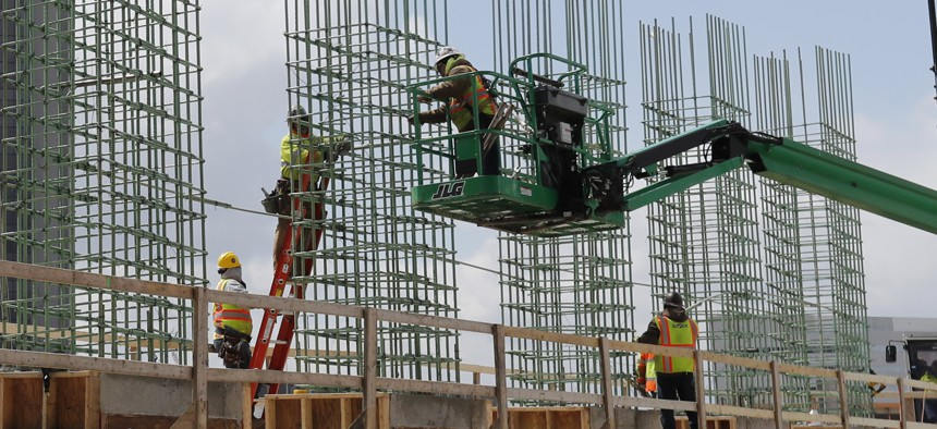 Work continues on a bridge on the Interstate Highway 75 project, Thursday, April 16, 2020, in Troy, Mich.
