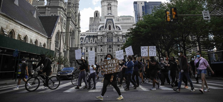 Protesters march in Philadelphia, Monday, June 1, 2020 calling for justice over the death of George Floyd.