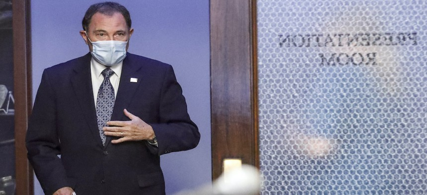 Utah Gov. Gary Herbert wears a mask as he waits in the hallway before the start of the daily briefing on the state's efforts to fight Covid-19 Wednesday, June 24, 2020, in Salt Lake City.